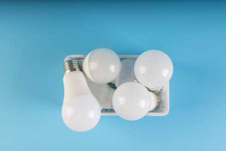 light bulbs in collection isolated on blue background