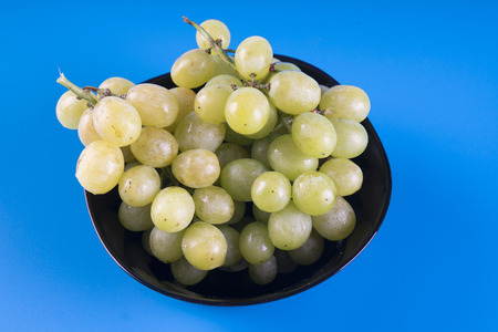 grapes in bowl isolated