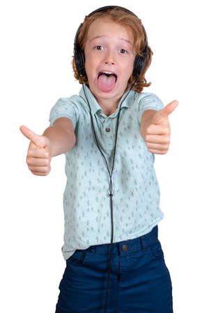 happy child listening music with headphones thumbs up
