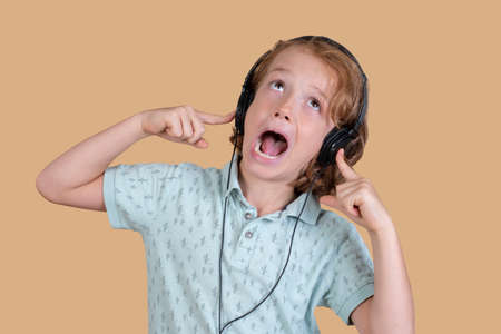 child with loud music on headphones
