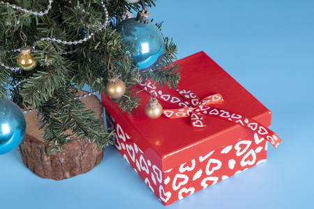 present and christmas tree close up