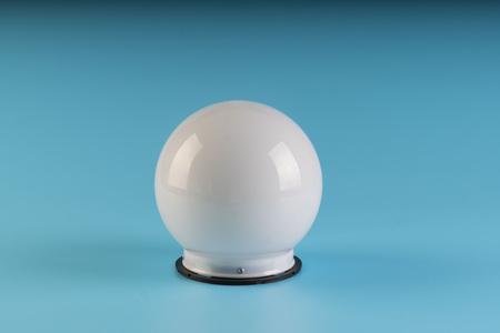 white round lamp isolated on blue background Stock Photo