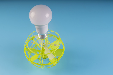green electricity light bulb connected with wind energy