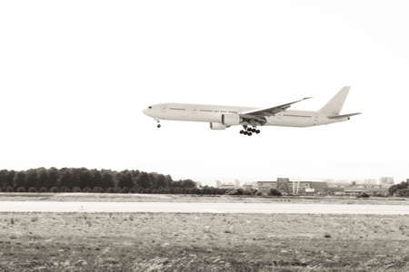 Plane landing to Airport. Black and white. No trademark on.