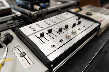 Vintage DJ setup. Sound studio audio equipment control panel.
