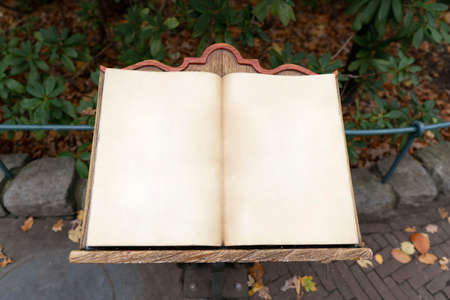 Empty vintage fairytale book on wood construction. Open air parking area. Stock Photo