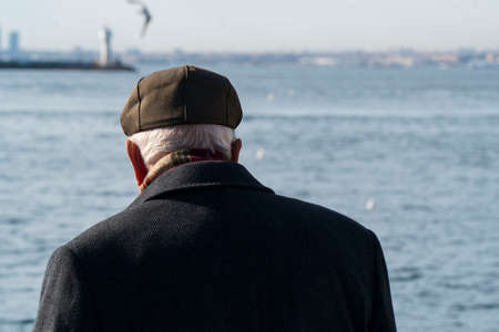 Lonely old man looking to sea.