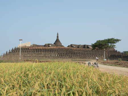 travel to Kothang Paya with rice field sideways, Koe Thang Paya, Mrauk-U, Myanmar