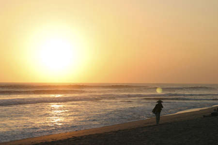 kuta: Sunset and seller at Kuta Beach Bali