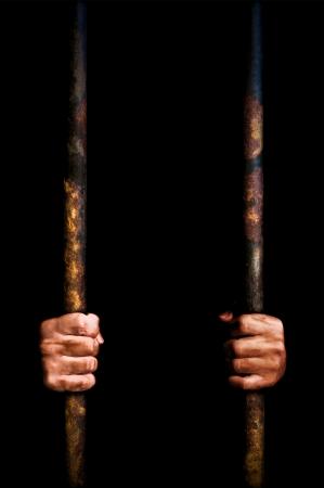 grasping: Prisoner grasping the bars Stock Photo