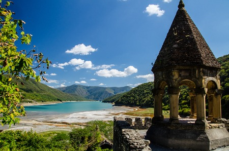 Church of the Mother of God, Ananuri with Zhinvali reservoir in the background and blue sky with few clouds above