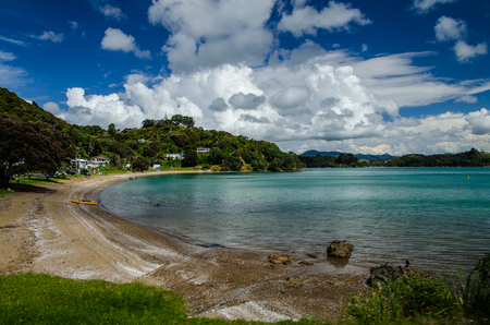 Coastline view with blue sky and white clouds above at Coromandel Peninsula, North Island, New Zealand.