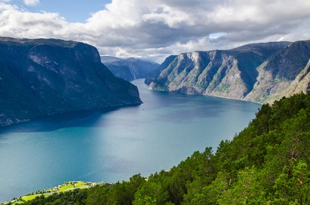 Amazing view fro the Stegastein lookout with a small boat sailing on the Aurlandfjord.