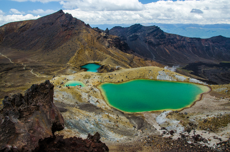 View of Emerald lakes from Tongariro Alpine Crossing hike with clouds above, North Island, New Zealand Stock fotó