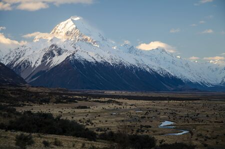 Snow covered Mount Cook at sunset golden hour, South Island, New Zealand