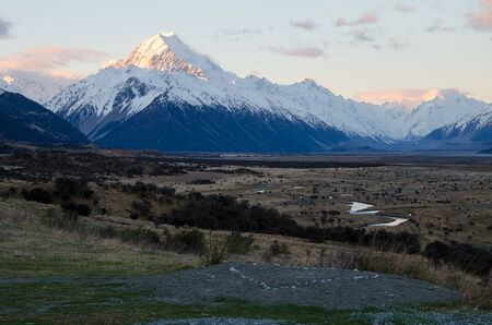 Snow covered Mount Cook with heart in the foreground at sunset golden hour, South Island, New Zealand