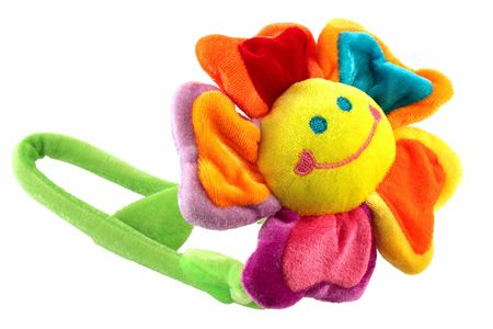 snugly: Happy smiling flower toy very colourful, isolated Stock Photo
