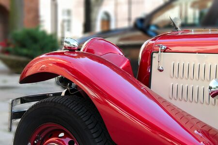 luxuriance: Old ancient car, full of chrome, red and cream-coloured