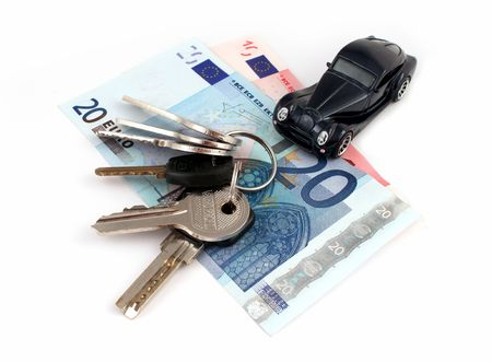 Keys, money and a car means prosperity, isolated photo
