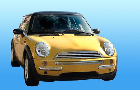 sumptuousness: Small yellow car isolated on blue backrground