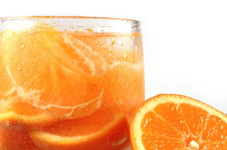 Fresh orange juice with orange pieces, isolated photo