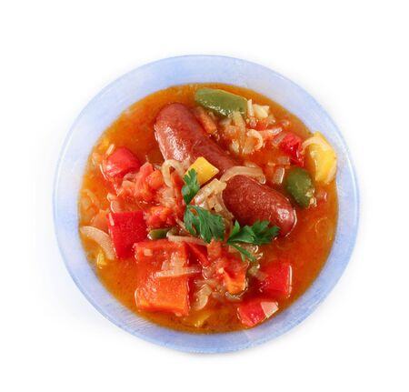 Sausage and boiled vegetables on a plate isolated photo