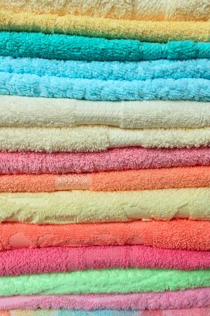 orange washcloth: Stacked colorful towels closeup many colours