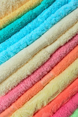 Stacked colorful towels closeup many colours photo