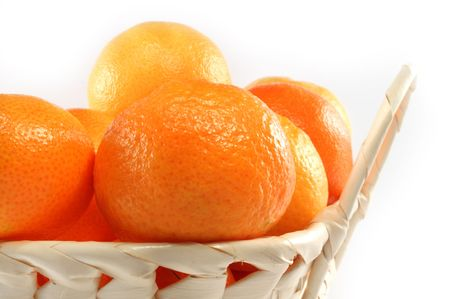 Fresh isolated tangerine in white basket Stock Photo - 5924038