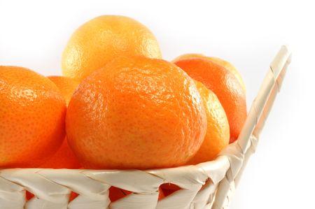 Fresh isolated tangerine in white basket Stock Photo - 5924038