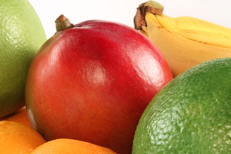 Fresh mango and colorful fruits composition photo