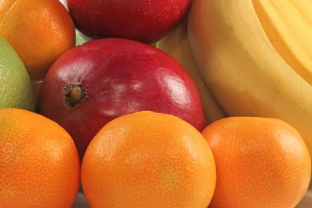 Fresh colorful fruits composition mango; bananas and tangerine Stock Photo - 5941015