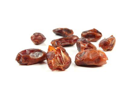 dactylifera: Dried red date - PHOENIX DACTYLIFERA isolated on white Stock Photo