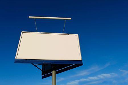 hoarding: Empty billboard on blue sky. Stock Photo