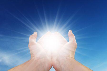 joy of life: Mans hands holding sun rays Stock Photo