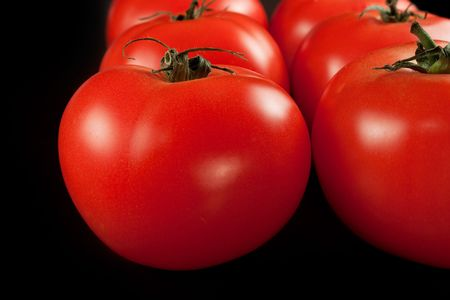 nutricion: A few tomatoes isolated on black  background