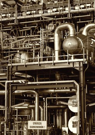Pipes, tubes, machinery at a oil refinery plant  photo