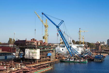 Shipyard - ship in a dry dock photo