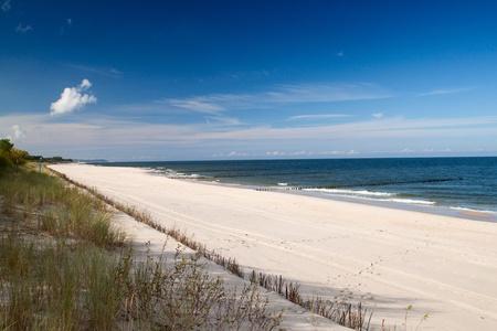 baltic: Empty Baltic sea beach with blue sky