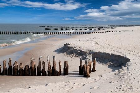 breakwaters: Wooden breakwaters at Baltic sea coast.