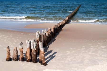 baltic sea: Wooden breakwater at Baltic sea coast. Stock Photo