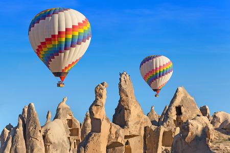Hot air balloon flying over rock landscape at Cappadocia Turkey. Reklamní fotografie