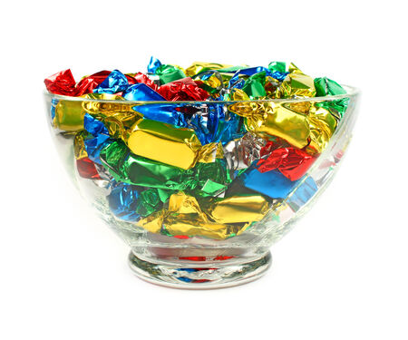 hard candy: Candies wrapped in colored foil on white background