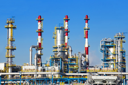 refineries: Petrochemical plant over blue sky. Stock Photo