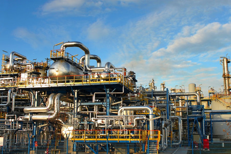 refinery: Petrochemical plant, oil refinery factory over blue sky. Stock Photo