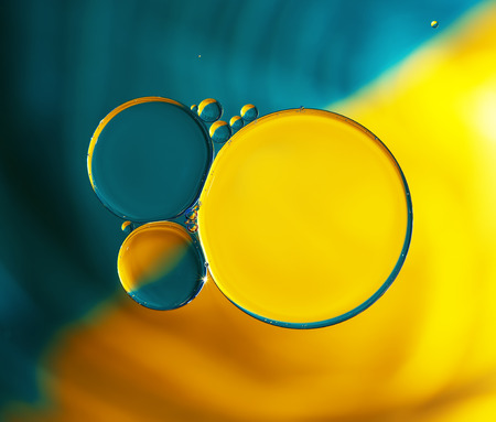 Abstract background,colorful oil droplets on water surface. Beautiful macro abstraction Standard-Bild