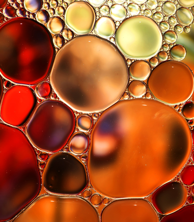 droplets: Abstract background with oil drops on water.