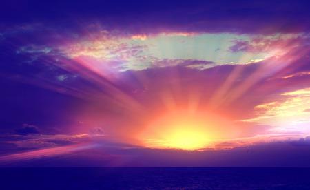 cross process: Vintage photo of beautiful sunset over sea with sun beams