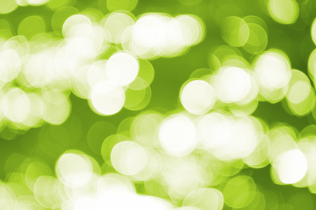 Blurry abstract background, green defocused bokeh lights, useful as background