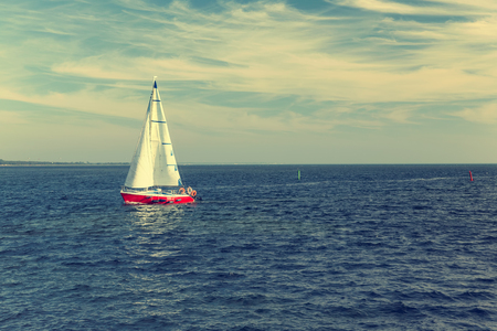 dinghies: Racing yacht in the Baltic sea on blue sky background